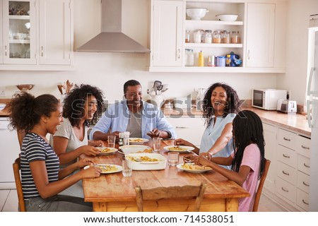 Family With Teenage Children Eating Meal In Kitchen #714538051