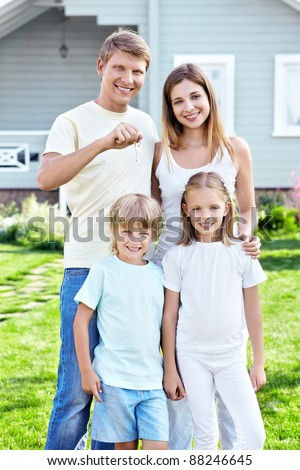 Family with the keys in the background house
