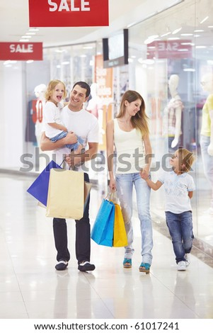Family with two children in the store