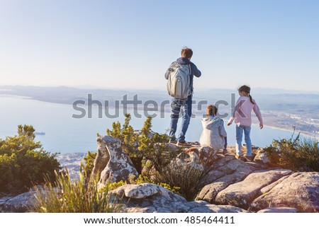 Family with two kids enjoying breathtaking views of Cape Town from top of Table mountain