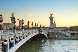 famous Alexandre III Bridge at sunset in  Paris, France