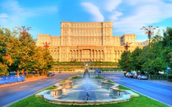 Famous and biggest building of the world, Palace of Parliament illuminated by sunrise light in the most beautiful place of Bucharest, capital of Romania in Eastern Europe