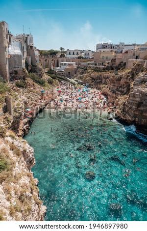 famous and crowded Lama Monachile Beach in Polignano a Mare, Puglia Сток-фото ©