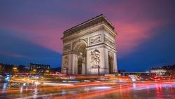 Famous Arc de Triomphe at twilight in Paris, France