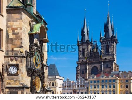 Famous Astronomical Clock (Orloj) and the Tyn Church in Prague, Czech Republic