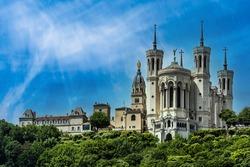 famous basilica notre dame de fourviere in lyon france with blue sky