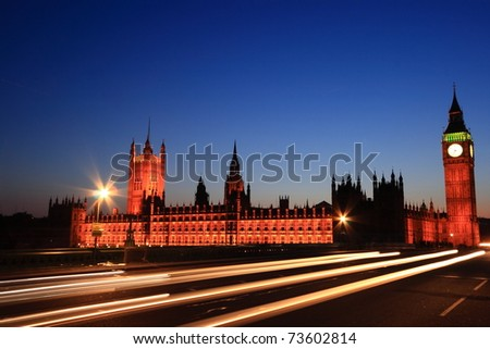 Famous Big Ben clock tower with light beam from cars in London at twilight time,UK.