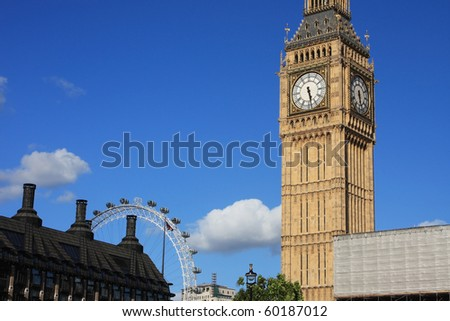 Famous Big Ben clock tower with London eye, in London, UK.