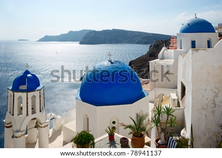 Famous Blue Domed churches on the sea background in Santorini, Greece.