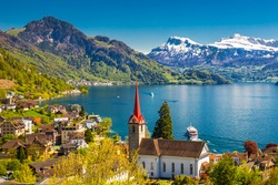 Famous boats on lake Lucerne (Vierwaldstatersee) in Weggis village with the view of Pilatus mountain and Swiss Alps in the background near famous Lucerne (Luzern) city, Switzerland