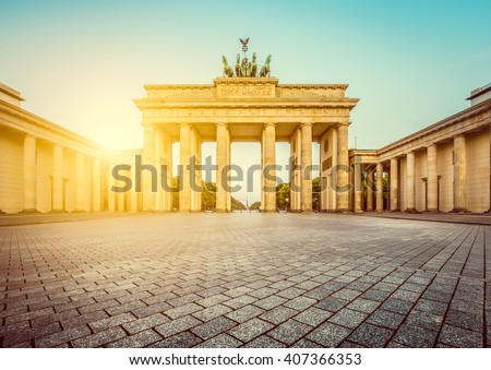 Famous Brandenburger Tor (Brandenburg Gate), a major landmark and national symbol, in golden morning light at sunrise with retro vintage Instagram style pastel toned filter effect, Berlin, Germany