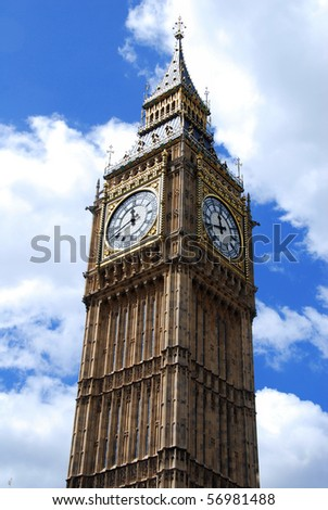 """Famous British clock tower """"Big Ben"""" against the blue sky"""