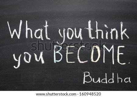 "famous Buddha quote ""What you think you become"" handwritten on blackboard"