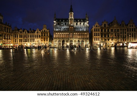 Famous building: Maison du Roi (The King's House or Het Broodhuis) in Brussels, Belgium. Located on Grote Markt (Main Square). Rainy evening, wet cobble stones.