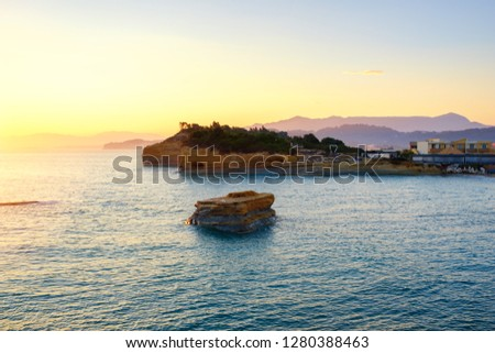 Famous Canal d'Amour beach with beautiful rocky coastline in amazing blue Ionian Sea at sunrise in Sidari holiday village on Corfu island in Greece, Europe
