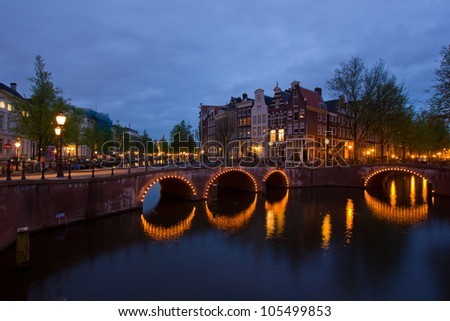 famous canals and bridgres  of Amsterdam in night, Netherlands
