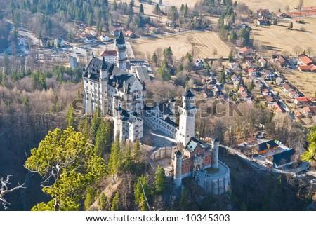 Famous castle Neuschwanstein. Bavaria, Germany. Birds-eye view from a mountain.
