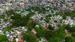 Famous cemetery in the city of Manila, where people live among the graves and crypts top view. Travel concept.