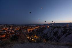 Famous center of balloon fligths Goreme at night. Balloons take off at sunrise. Goreme, Cappadocia, Turkey. Famous center of balloon fligths.