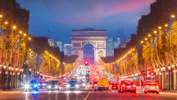 Famous Champs-Elysees and Arc de Triomphe at twilight in Paris, France