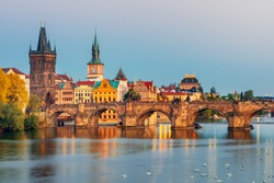 Famous Charles bridge and historical center of Prague, buildings and landmarks of old town at sunset, Prague, Czech Republic
