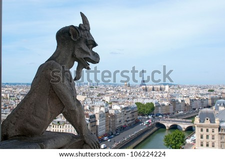 Famous Chimera (demon) overlooking the Eiffel Tower from Notre Dame of Paris