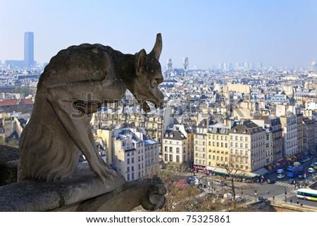 Famous chimera of Notre-Dame overlooking Paris. View from the top of Notre-Dame de Paris, France.