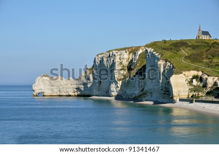 "Famous cliffs ""d'Amont"" of Etretat and arche ""Le Chaudron"" and the chapel ""Notre-Dame de la Garde"", commune in the Seine-Maritime department in the Haute-Normandie region in northwestern France"
