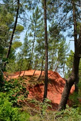 Famous cliffs of the ochre at Roussillon, located 10 kilometres west of Apt and 50 kilometres from Avignon in region Provence in France. Ochre is a natural pigment with indelible colour