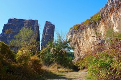 Famous cut into two pieces rock at Gortalovo gorge, Pleven, Bulgaria at autumn.