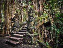 Famous dragon bridge in Monkey Forest Sanctuary in Ubud, Bali, Indonesia.
