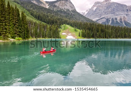 Famous Emerald Lake, Yoho National Park, British Columbia, Canada. Turquoise water and green trees. Red canoe on the lake. #1535454665