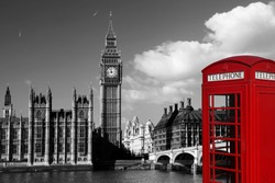 Famous English red telephone boxes with Big Ben in London, UK
