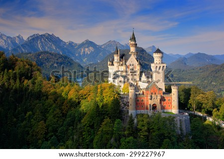 Famous fairy tale Neuschwanstein Castle in Bavaria, Germany,  late afternoon with blue sky with white clouds