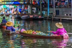 Famous floating market in Thailand, Damnoen Saduak floating market, tourists visiting by boat, Ratchaburi, Thailand.