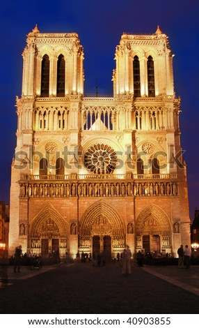 Famous French cathedral Notre Dame in Paris. Shot shortly after sunset.