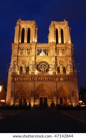 Famous French cathedral Notre Dame in Paris. Shot shortly after sunset. - stock photo
