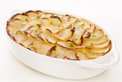 Famous French dish of potatoes and onions baked with stock, Boulangere Potatoes,