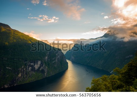 Famous Geirangerfjord on a beautiful evening in Norway #563705656