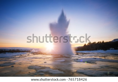 Famous Geysir in Iceland in beautiful sunset light. One of the most famous natural heritage on Iceland.