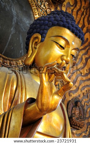 Famous giant seated Buddha at Lingyin Temple, Hangzhou, Shandong Province - stock photo