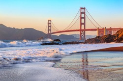 Famous Golden Gate Bridge view from Baker Beach at sunset in San Francisco, California