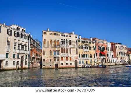 Famous Grand Canal in Venice, Italy. Beautiful old architecture of Cannaregio district with arch windows and interesting balconies.