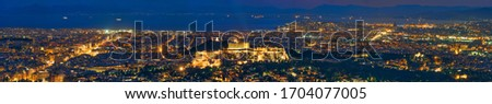 Famous greek tourist landmark - the iconic Athens view and Parthenon Temple at the Acropolis of Athens and panorama of Athenes as seen from Mount Lycabettus, Athens, Greece