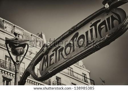 Famous historic Art Nouveau entrance sign for the Metropolitain underground railway system in Paris, France
