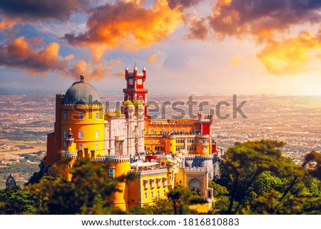 Famous historic Pena palace part of cultural site of Sintra against sunset sky in Portugal. Panoramic View Of Pena Palace, Sintra, Portugal.  Foto stock ©
