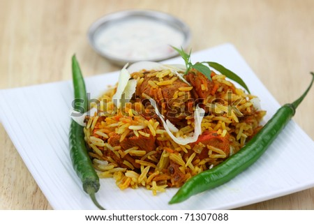 Famous Indian dish chicken biryani made with spices and rice