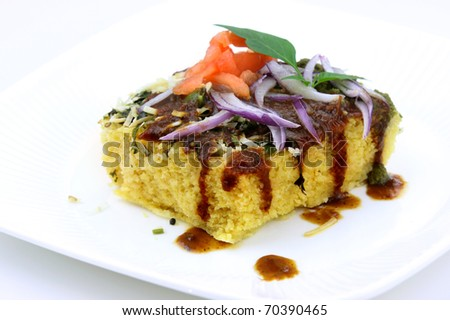 Famous Indian snack Dhokla on white background