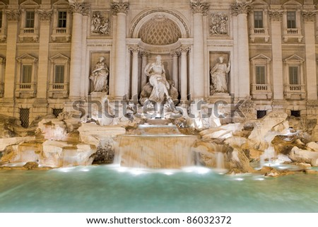 Famous Italy Rome landmark the biggest baroque sculptural aqueduct fountain di trevi by Nicola Salvi lighted in twilight