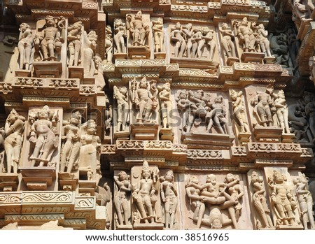 Famous Kamasutra Scenes On The Wall Of Hindu Temple In Khajuraho,India
